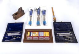Two cased sets of drawing instruments, a miniature plane and other items