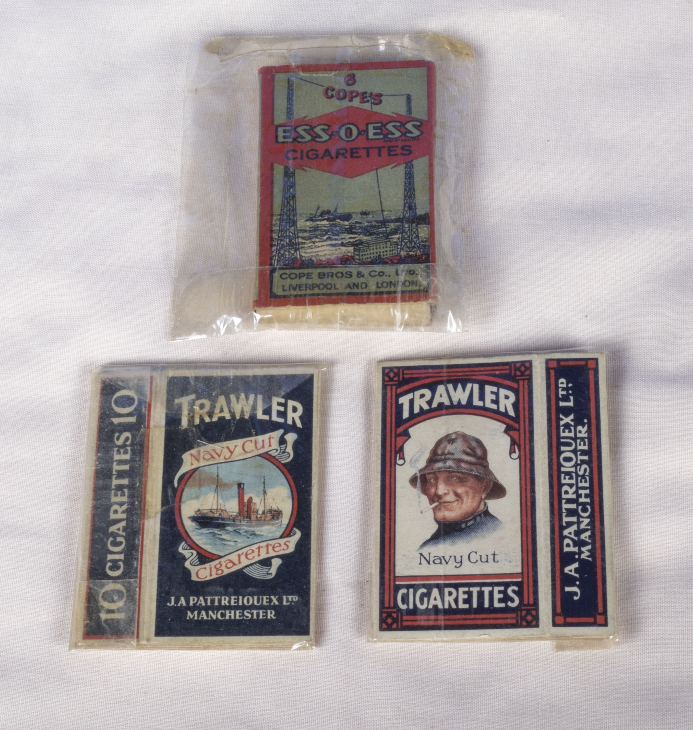 Three vintage cigarette packets circa 1920s J Pattreiquex Ltd. Manchester, Trawler Navy Cut and