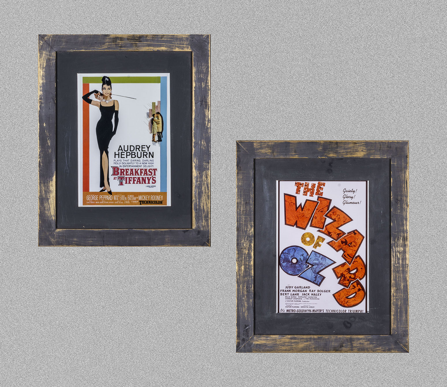 Two framed advertising prints Breakfast at Tiffany's and The Wizard of Oz, both 43cm x 54cm