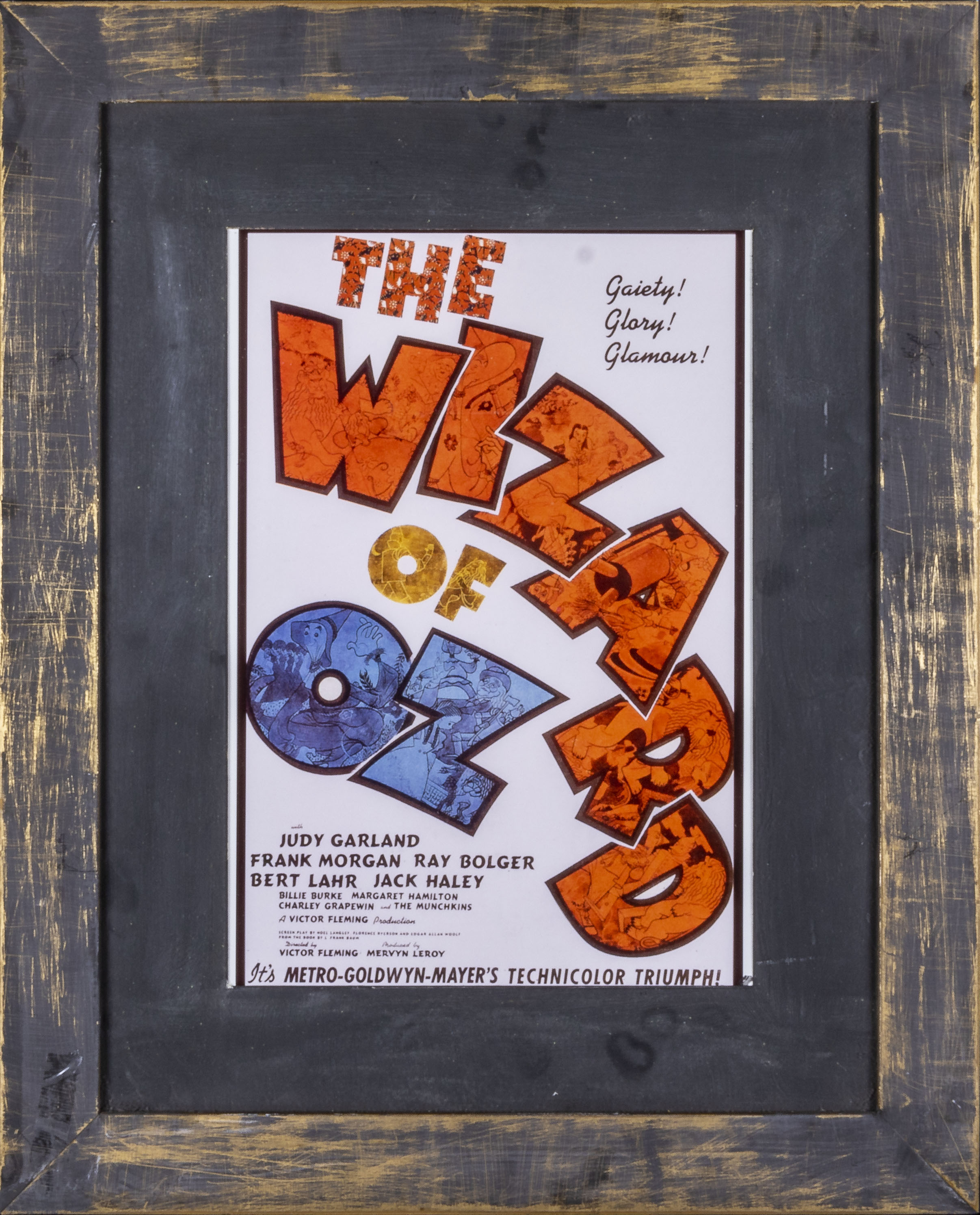 Two framed advertising prints Breakfast at Tiffany's and The Wizard of Oz, both 43cm x 54cm - Image 3 of 3