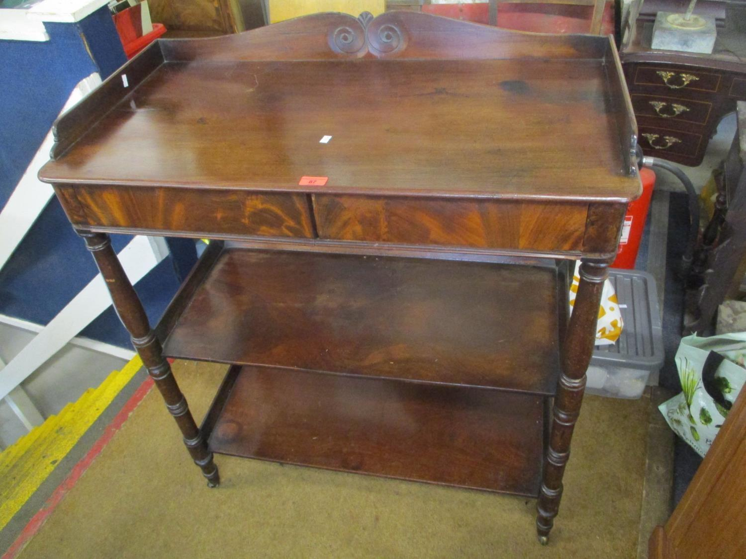 "Lot 87 - A Victorian mahogany three tier buffet stand having two inset drawers and turned legs 38 1/2""h x"