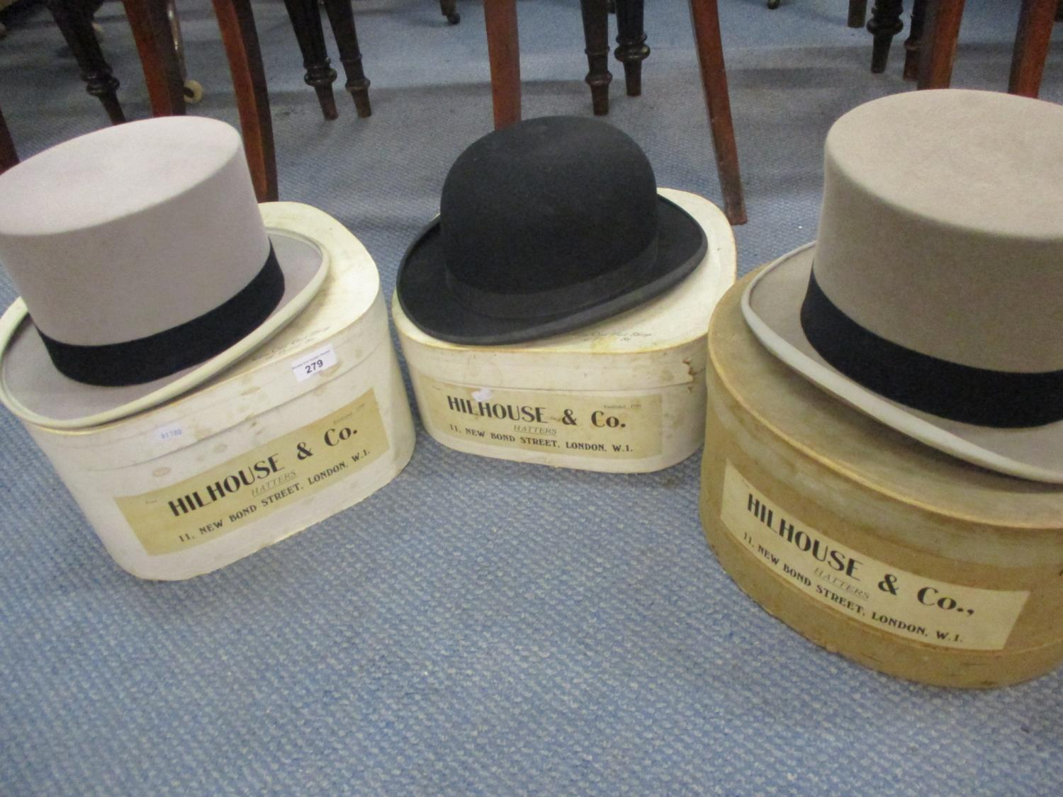 Hillhouse & Co, three gents hats comprising a bowler hat and two grey top hats together with three