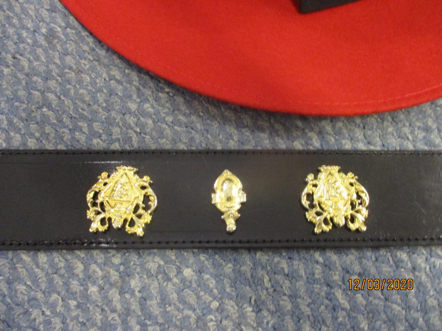 Lot 245 - A Harrods black leather belt with five gilt coat of arms style badges, size 85, together with a