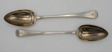 A pair of George III silver serving spoons by Peter Williams Bateman, London 1812, in the Old