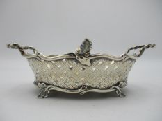 A Victorian silver basket by Joseph Rodgers & Sons, Sheffield 1898, modelled with pierced woven