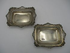 A pair of small Victorian silver baskets by William Comyns & Sons, London 1895, of rectangular form,