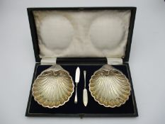 A cased pair of George V silver butter dishes by Harrison Brothers and Howson, Sheffield 1921,