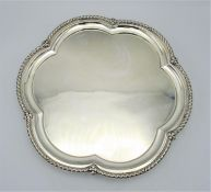 A George V silver salver by Levesley Brothers, Sheffield 1910, with lobed rim with flower detail