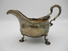 A George II silver sauce boat by Daniel Smith & Robert Sharp, London 1759, modelled with a gadrooned