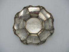 A George VI silver dish by Adie Brothers Ltd, Birmingham 1937, modelled with faceted everted