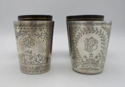 Two late Victorian silver beakers by Edwin Charles Purdie, London 1883 and 1887, both etched with
