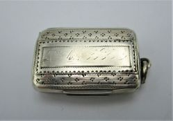 A George III silver vinaigrette by Joseph Willmore, Birmingham 1813 of cushion form with engraved