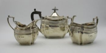 A late Victorian silver three piece tea set by John Round & Son, Sheffield 1895, retailed by Edwards