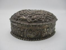 A Victorian silver table box by Horton & Allday, Birmingham 1888, almond shaped with repousse