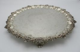 A Victorian silver salver by the Goldsmiths Alliance Ltd, London 1867, of circular shape with
