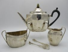 A George V silver three piece tea set by Alexander Clark & Co Ltd, Sheffield 1923, comprising a