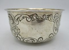 A Victorian silver sugar bowl by Edwin Charles Purdie, London 1900, with a rolled rim, scroll,