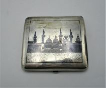 An early 20th century Egyptian silver Niello card case of curved, cushion form decorated with the