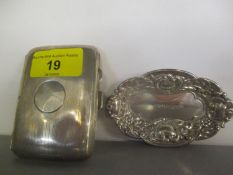 An early 20th century silver cigarette case, together with a silver embossed trinket dish, 84.9g