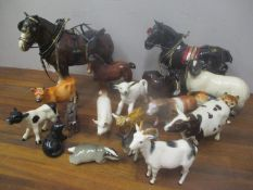 A selection of model animals to include a Beswick bull, Beswick pig, a Royal Doulton goat and others