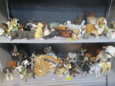 Mixed animal ornaments to include a USSR tiger, giraffe, Beswick dogs and others