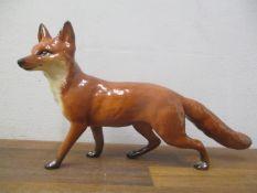 A Beswick ornament of a fox