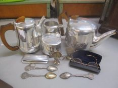A mixed lot to include a Picquot ware four piece tea and coffee service, a 9ct gold opal set ring,