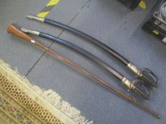 Two Indian swords with scabbards together with a copper coaching horn