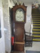 A George III eight day longcase clock with cross banded decoration and painted dial 225cm high