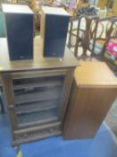 An Ercol Golden Dawn hi-fi cabinet containing a Denon stereo system with a Sony turntable,