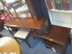 A Stag mahogany dressing table, together with a stool, chest of drawers, a bedside table and a