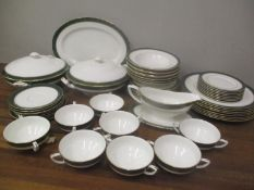 A Royal Worcester Cavendish leather green pattern china dinner service