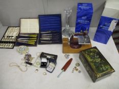 A mixed lot of costume jewellery, boxed silver plated cutlery and a child's sewing machine, along