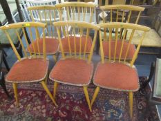 A set of six vintage Ercol blonde elm and beech stick back dining chairs with later padded seats