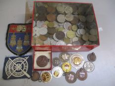 A mixed lot of coins and badges to include 1940s Athletics Club badges and others