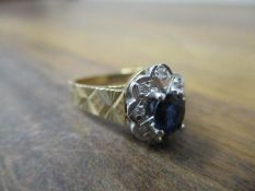 A 9ct gold ring set with a sapphire and diamond, 3.5g