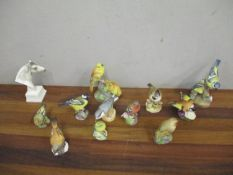 Eleven Royal Worcester model birds to include Blue Tits, Yellow Hammers and others, along with a