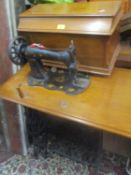 A late 19th/early 20th century Singer treadle sewing machine table