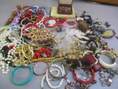 A mixed lot of costume jewellery to include beaded necklaces, bangles, earrings and other items