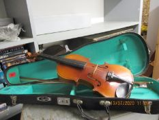 A Lark Chinese violin with bow in a carrying case Location: RWM