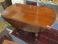 A 19th century oak drop leaf dining table and two additional mahogany leaves