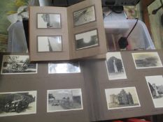 Two early 20th century photograph albums, together with mixed books to include Winston Churchill The