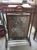 An early 20th century mahogany framed fire screen with inset tapestry Location:RWM