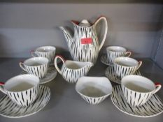 A Midwinter Stylecraft coffee set, complete, six setting (Please note the photograph depicts a