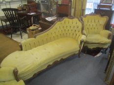 A reproduction French style walnut chaise longue and a pair of matching armchairs