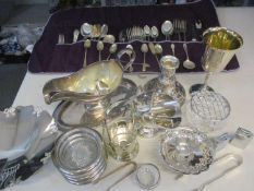A quantity of silver plate, white metal and silver items to include cutlery and flatware, all housed