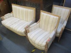 A Harrods Louis XV1 style part gilt beech framed open suite with carved ornament on turned legs,