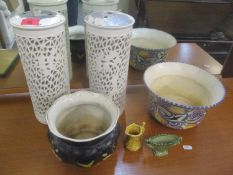 A mixed lot to include a pair of Chinese pierced vases, Poole pottery bowl and other items
