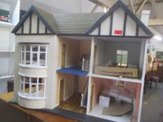 A part finished scratch built dolls house, 65cm high x 85cm wide. Location:RWM