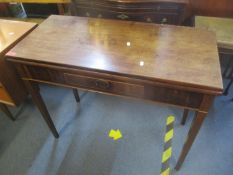 An early 19th century mahogany fold over tea table having single inset drawer and tapering legs, 73h
